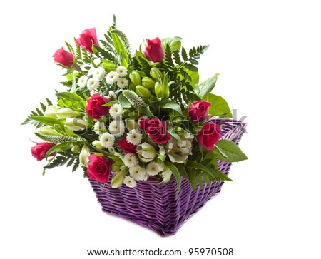 Colorful bouquet with pink roses in purple basket over white