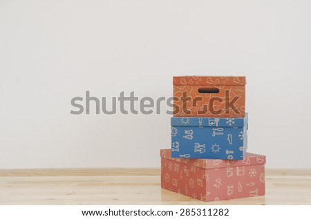 Colorful boxes in empty room - stock photo