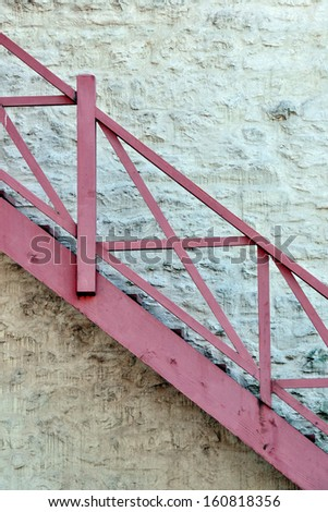 Colorful brick wall and stairs background from old building in Quebec City - stock photo