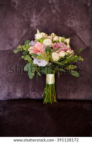 Colorful bridal bouquet on a purple chair