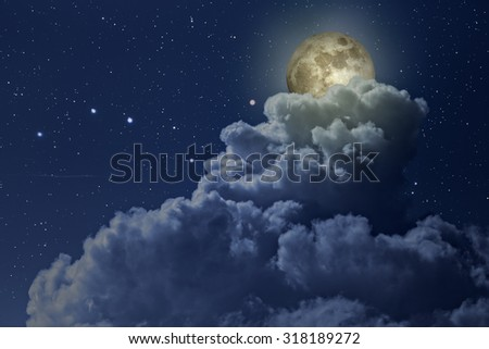 Colorful bright night with stars and full moon arising behind a strong cloud - stock photo