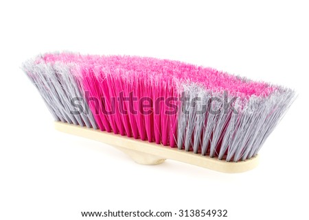 Colorful broom isolated on white background. - stock photo