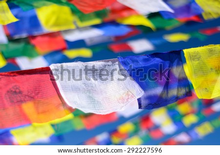 Colorful Buddhist prayer flags on the wind