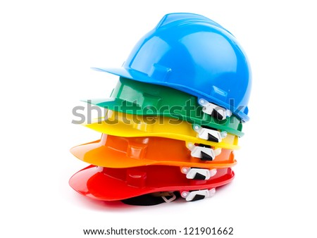 colorful builder safety hardhats - stock photo