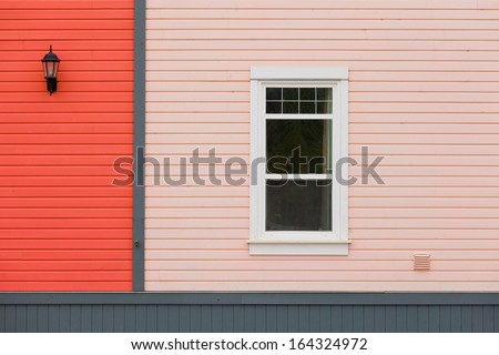 Colorful building facade with window and exterior lamp as architecture background pattern abstract