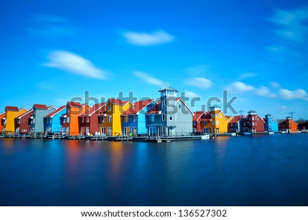 colorful buildings at Reitdiephaven on water in Groningen, Netherlands - stock photo