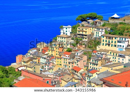 Colorful buildings near the harbor of Riomaggiore, Cinque Terre, Italy - stock photo