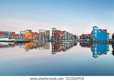 colorful buildings on water at haven, Groningen, Netherlands - stock photo