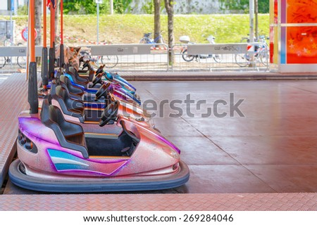 Colorful bumper cars for children in line. - stock photo