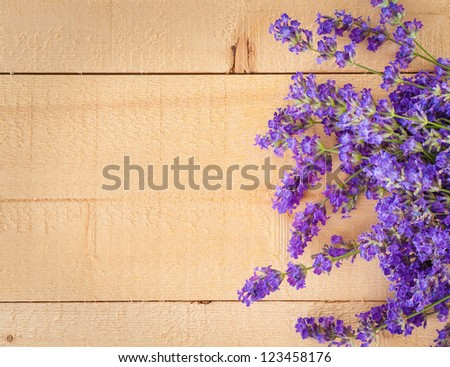 Colorful Bunch of Fragrant Lavender Flowers on Wood Background with Copyspace, Horizontal that can be Vertical - stock photo