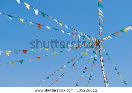 Colorful Bunting or triangle flag on the ropes and sky