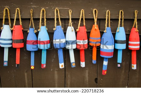 Colorful buoys on a wall of a shack in Maine, USA - stock photo