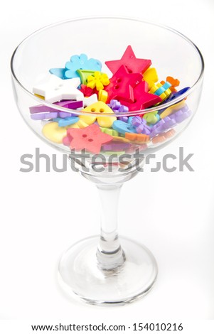 Colorful buttons in a glass on a white background - stock photo