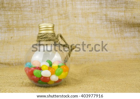 Colorful candies in bottles with shallow depth of field (dof) - stock photo