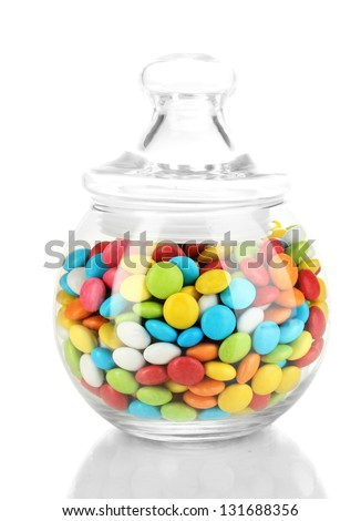 Colorful candies in glass jar isolated on white