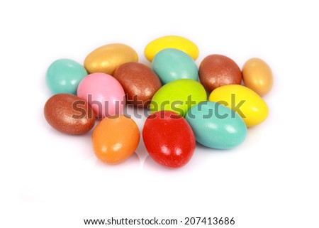 Colorful candies isolated on white background. Shallow DOF - stock photo