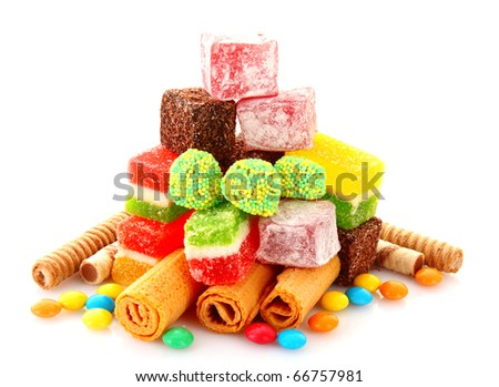 colorful candies jelly on yellow background - stock photo