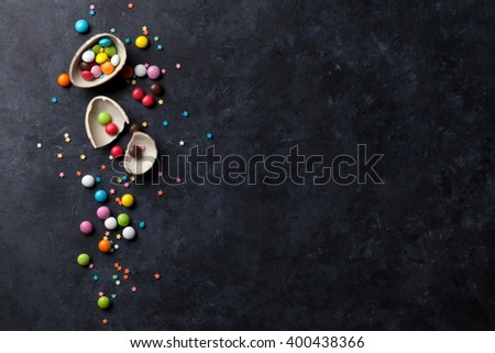 Colorful candies on stone background. Top view with copy space - stock photo