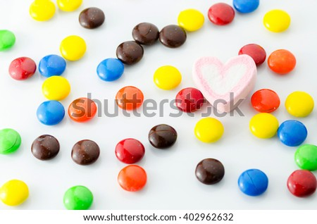 Colorful candies on white background - stock photo