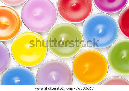 Colorful candles on white background - stock photo