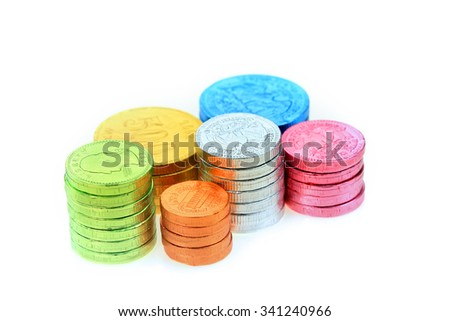 Colorful candy coins on white background - stock photo