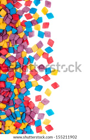 Colorful candy decoration over white background with copy space - stock photo