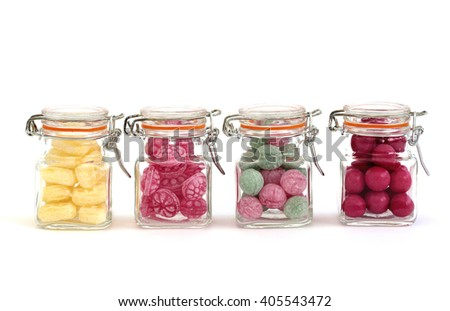 Colorful candy in jars - stock photo