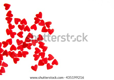 Colorful candy red hearts sprinkles isolated on white background card