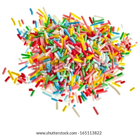 Colorful candy sprinkles heap close up isolated on white background  - stock photo