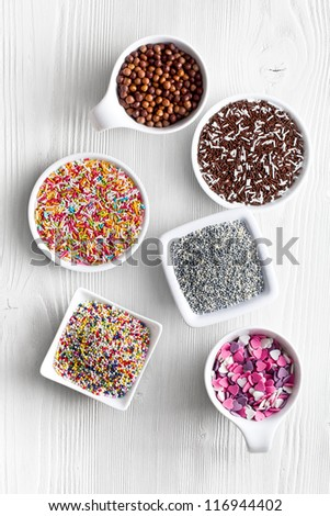 colorful candy sprinkles in ceramic bowl - stock photo