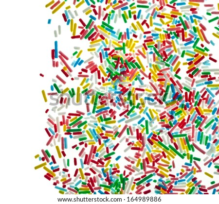 colorful candy sprinkles top view surface close up isolated on white background