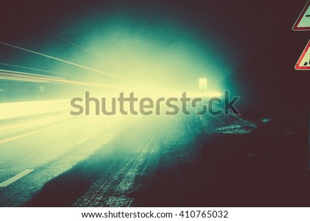 Colorful car light trails in the road at night. - stock photo