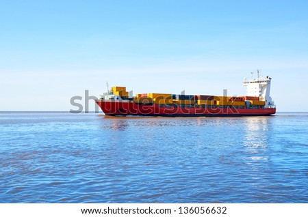 colorful cargo container ship sailing - stock photo