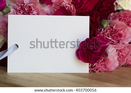 Colorful carnations and greeting card for Valentine's Day, Mother's Day or just because. - stock photo