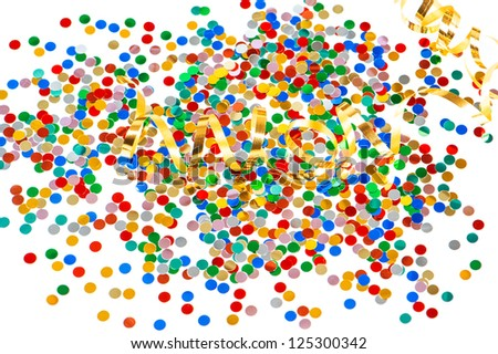 colorful carnival party decoration with assorted confetti with golden streamer on white background - stock photo