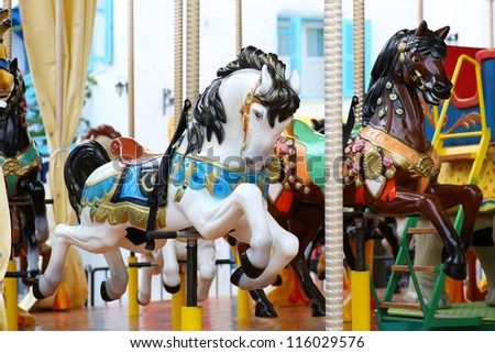 Colorful carousel - stock photo