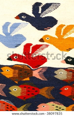 Colorful carpet with bird and fish patterns hanging on the market. Oaxaca, Mexico - stock photo