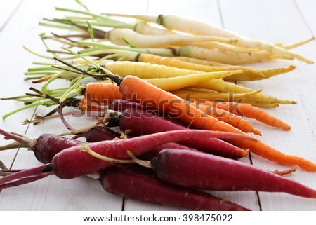 Colorful carrots on the table - stock photo