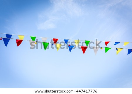 Colorful celebration flags on two strings - stock photo