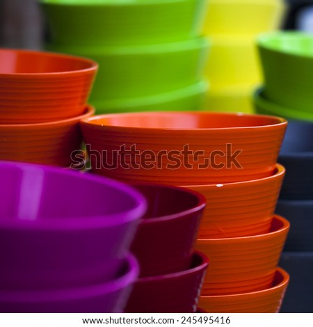 colorful ceramic pots in glaze for sale. Square format - stock photo