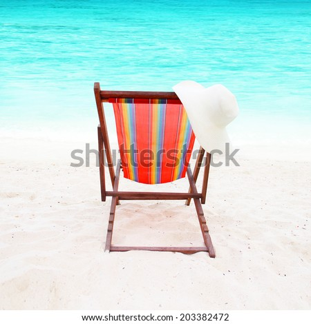 colorful chair on white sand on a beautiful beach - stock photo