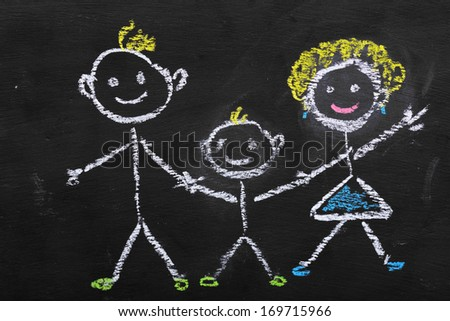 Colorful chalk illustration of family by kid on blackboard  - stock photo