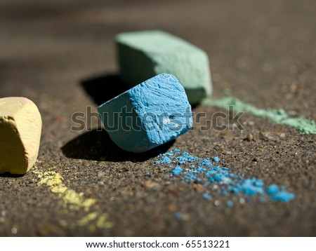 Colorful chalk on asphalt