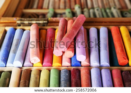 Colorful chalk pastels in box close up - stock photo