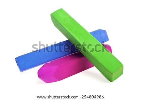 Colorful chalks on a white background - stock photo