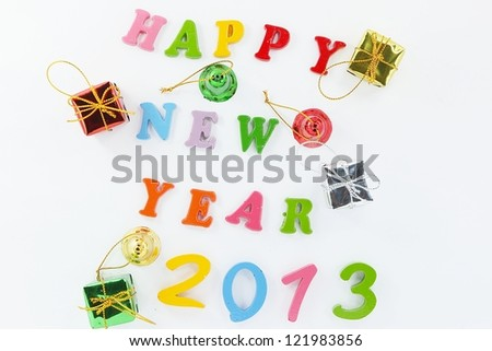 Colorful character made from resin. Happy New Year  and  Gift. - stock photo