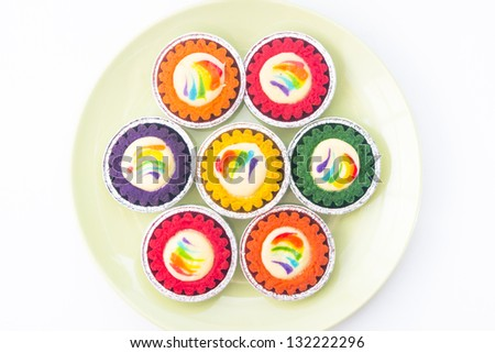 Colorful cheese tarts on plate