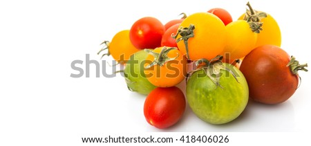 Colorful cherry tomatoes over white background