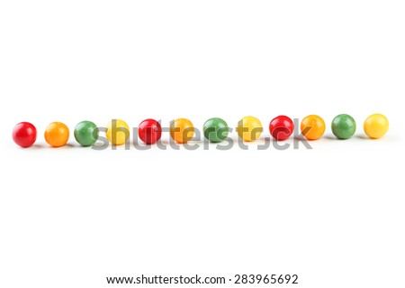 Colorful chewing gums isolated on white  - stock photo