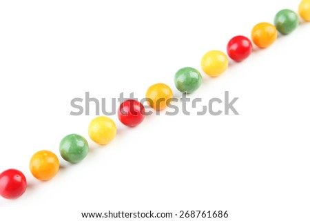 Colorful chewing gums on white background - stock photo